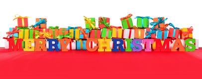 Bunter Text der frohen Weihnachten und varicolored Geschenke Stockfotos