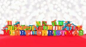 Bunter Text der frohen Weihnachten und varicolored Geschenke Stockbild