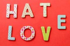 Bunter Text, Hass und Liebe Stockbild