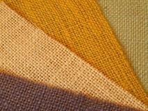 Bunter Textilhintergrund in der Diagonale Stockbild