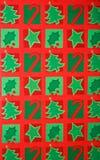 Bunter Weihnachtsgeschenk-Verpackungs-Papier-Hintergrund Stockbild