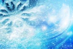 Bunter Weihnachtshintergrund mit Schneeflocken und Sternen auf einem blauen Hintergrund Stockfoto