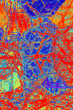 Buntes, abstraktes Muster des Minerals in einem Polarisierungsmikrographen Stockbild
