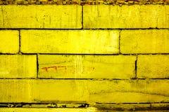 Buntes Backsteinmauermuster, gemalte Ziegelsteine als städtische Beschaffenheit Lizenzfreies Stockbild