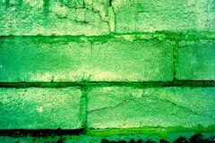Buntes Backsteinmauermuster, gemalte Ziegelsteine als städtische Beschaffenheit Stockfotos