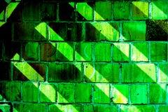 Buntes Backsteinmauermuster, gemalte Ziegelsteine als städtische Beschaffenheit Lizenzfreie Stockfotos
