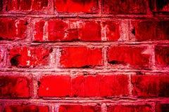 Buntes Backsteinmauermuster, gemalte Ziegelsteine als städtische Beschaffenheit Stockbild