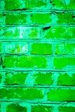 Buntes Backsteinmauermuster, gemalte Ziegelsteine als städtische Beschaffenheit Lizenzfreies Stockfoto