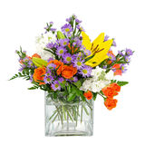 Buntes Blumenanordnungsmittelstück stockfotografie