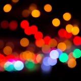 Buntes bokeh auf einem dunklen Hintergrund Defocused bokeh lignts Abstraktes Weihnachten-batskground Abstrakter Kreis-bokeh Hinte Stockfoto