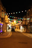 Buntes bokeh beleuchtet in einer Straße nachts Lizenzfreies Stockbild
