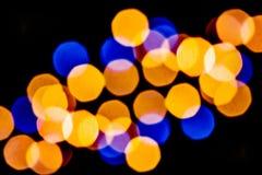 Buntes gelbes und blaues abstraktes bokeh Stockfotografie