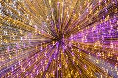 Buntes helles Verbreiten durch Zoomtechnikhintergrund und Beschaffenheit in der Nacht Stockfotos