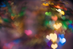 Buntes Herz bokeh mit Kopienraum Stockfotografie