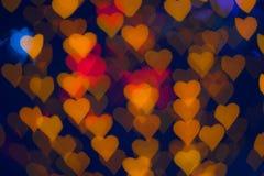 Buntes Herzen bokeh als Hintergrund Stockfotografie