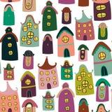 Buntes nahtloses Muster mit Karikaturhäusern Stockfoto