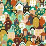 Buntes nahtloses Muster mit Karikaturhäusern Lizenzfreie Stockbilder