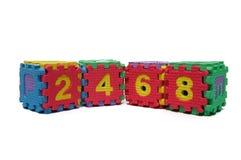 Buntes Würfelpuzzlespiel von geraden Zahlen Lizenzfreies Stockbild