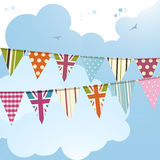 Bunting and blue sky 2. Bunting background with union jack flags against a blue sky Royalty Free Stock Photo