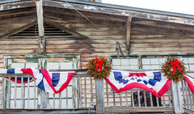 Bunting and Christmas Wreaths on Old Wood Building. In Key West Stock Photo