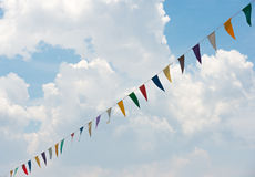 Bunting with cloud. Against colorfull multi Stock Image