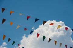 Bunting with cloud. Against colorfull multi Royalty Free Stock Photography