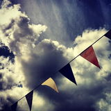 Bunting with Clouds. British Summer with bunting and dramatic clouds Royalty Free Stock Photo