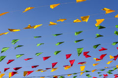 Bunting, colorful party flags, on a blue sky. Stock Images