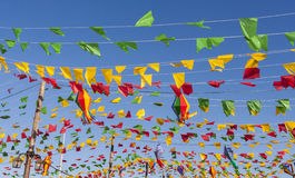 Bunting, colorful party flags, on a blue sky. Stock Image