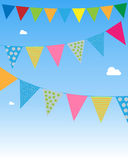 Bunting flags. Festive bunting flags hanging on blue sky. EPS file available Stock Photo