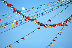 Bunting flags and lamps party. Flags and lamps hanging on a outdoor party Royalty Free Stock Images