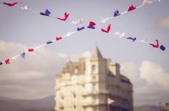 Bunting flags in LLandudno pier Wales, Cymru.  Stock Images