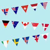 Bunting with flags of the most developed countries in the World. Over blue sky Royalty Free Stock Photos