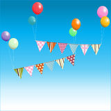 Bunting floating with balloons over blue sky Stock Images