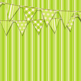 Bunting on a green striped background. Bunting flags on a green striped background Royalty Free Stock Photography