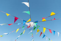 Bunting party Flags On A blue sky. Colorful bunting party Flags On A blue sky Stock Photo