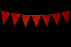 Bunting, seven red triangles on string for banner message Royalty Free Stock Images