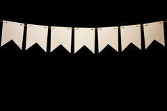 Bunting, seven white shapes on string for banner message. String with bunting seven white shapes. Add your own characters for title or banner Stock Photography