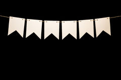 Bunting, six white shapes on string for banner message Stock Photo