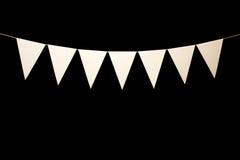 Bunting sju vita trianglar på rad för banermeddelande Fotografering för Bildbyråer