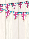 Bunting on a wooden background Royalty Free Stock Photo