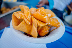 Bunuelos close up, traditional ecuadorian dessert served with honey and brown sugar Royalty Free Stock Photos