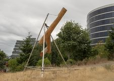 `Bunyon`s Chess` by Mark di Suvero, Olympic Sculptue Park, Seattle, Washington, United States. Pictured is a stainless steel and wood sculpture titled `Bunyon`s stock photography
