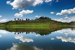 Bunyonyi lake in Uganda. Still lake with sky reflection Royalty Free Stock Photography