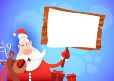 Buon anno della cartolina d'auguri di Buon Natale del bordo di Santa Claus Hold Big Empty Sign Fotografia Stock
