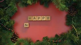 Buon anno, mano femminile che fa frase dei cubi sul fondo decorato video d archivio
