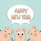 Buon anno nel fumetto con tre maiali sul backgrou blu Fotografia Stock