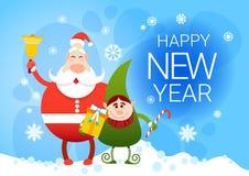 Buon anno sorridente del presente di festa di Santa Claus And Christmas Elf With Fotografia Stock Libera da Diritti
