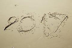 Buon anno 2017 sulla spiaggia Immagine Stock