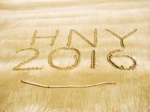 Buon anno 2016 sulla spiaggia di sabbia Fotografia Stock